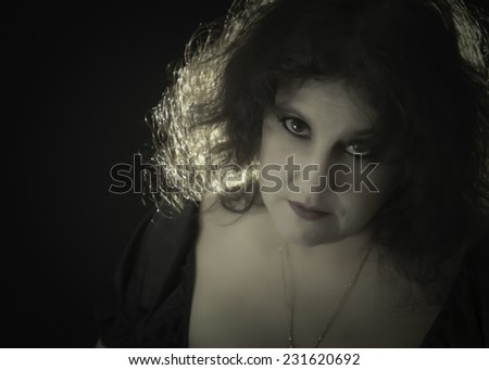 Dark 1920's Style Movie Portrait of a woman in Theatrical  make-up  - stock photo
