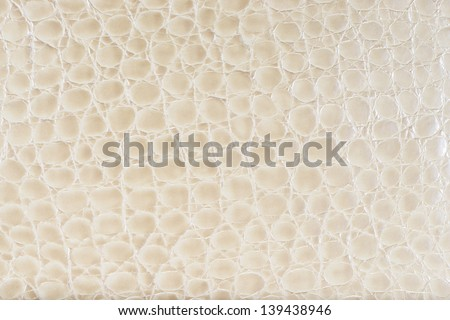 Dark salmon synthetic leather with embossed texture background