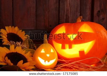 Dark scene of halloween pumpklins - stock photo