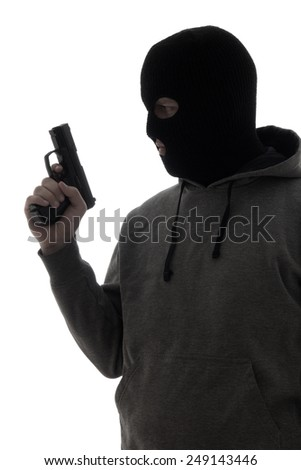 dark silhouette of criminal man in mask holding gun isolated on white background - stock photo
