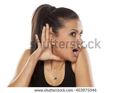 dark skinned beautiful young woman listening carefully - stock photo