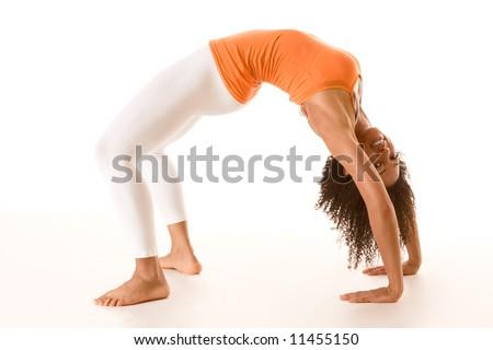 Dark skinned fit woman holding bridge stretching pose - stock photo