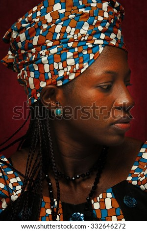 dark-skinned woman in a headscarf - stock photo