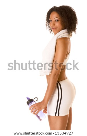 Dark skinned woman in sporty outfit holding bottle of water - stock photo