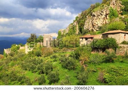 Dark sky cover the ruins of the byzantine city of Mystras, Greece - stock photo