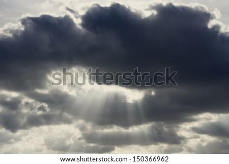 Dark sky, dramatic sky with sun beams - stock photo