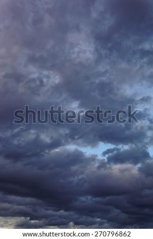 Dark sky with gloomy storm clouds. - stock photo