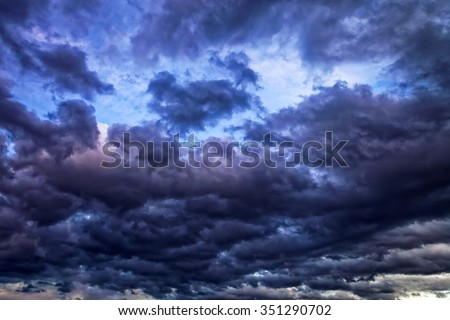 Dark sky with gloomy storm clouds. - stock photo