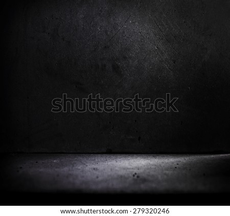 Dark stone or concrete room with slight incoming light. - stock photo