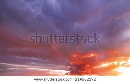 dark storm clouds before rain at sunset. - stock photo