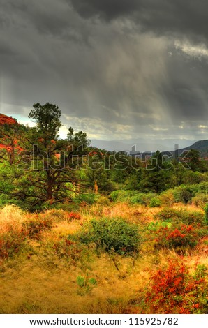 Dark storm clouds forming over Sedona Arizona - stock photo