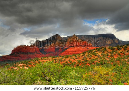 Dark storm clouds forming over the Sedona Arizona mountains - stock photo