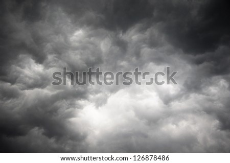 Dark storm sky with light part - stock photo