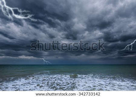 Dark stormy sky above the ocean surface.  - stock photo
