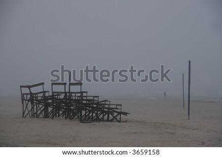 dark, stormy weather at the beach - stock photo