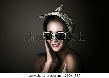 Dark Studio Fashion Portrait Of A Charming Retro Pin Up Woman Wearing Sunglasses And Head Scarf On Copy Space Background - stock photo
