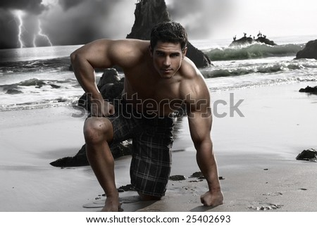 Dark stylized portrait of a young muscular shirtless man on the beach with storm and crashing waves in background - stock photo
