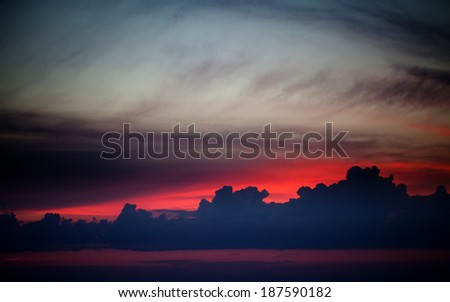 Dark sunrise sky on lake - stock photo