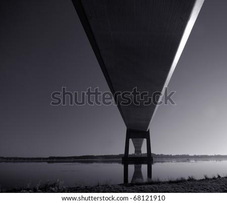 Dark suspension bridge - stock photo