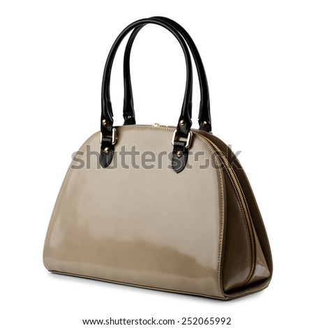 Dark tan brown glossy female handbag isolated on white background. - stock photo