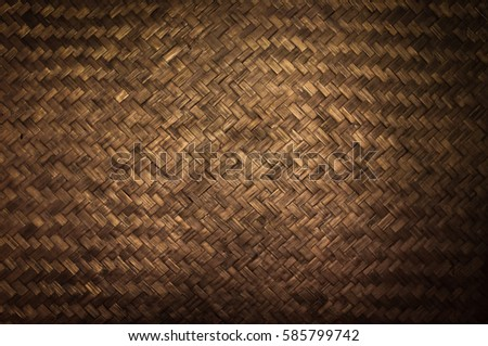 Dark Texture of bamboo handicraft detail , Pattern of Thai style bamboo handcraft texture background , vintage wall
