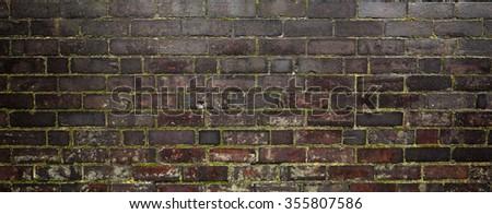 Dark tone brick wall background - stock photo