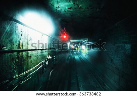 Dark underground tunnel. Grunge processed image with special grain and texture for more dramatic view  - stock photo
