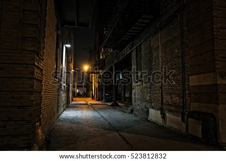 Dark urban city alley at night