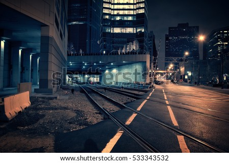 Dark urban downtown city train tunnel at night.