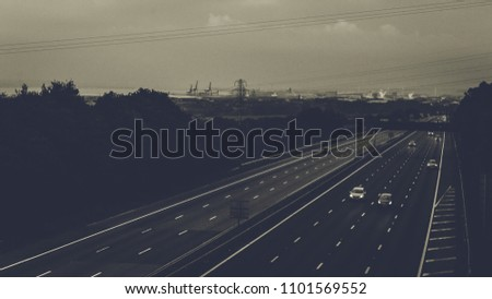 Dark View over English Motorway, Low Traffic, Landscape Horizontal Photography, Black and white Split Toning