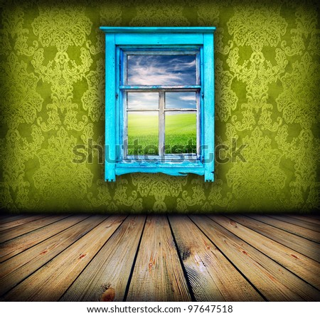 dark vintage green room with wooden floor and window with field and sky above it