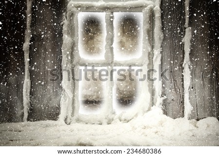 dark window and snow on wooden sill  - stock photo