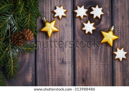 dark wooden background with fir branches, cookies and decorations, top view, horizontal - stock photo