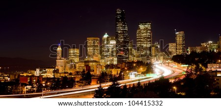 Darkness falls as Interstate 5 carries people on North through Seattle - stock photo
