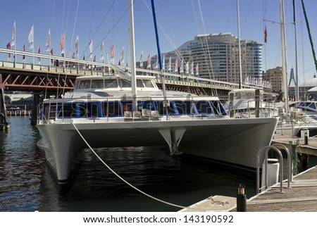 DARLING HARBOUR, SYDNEY - MAY 9: A catamaran anchored at the marina of Sydney's iconic Darling Harbour precinct on May 9, 2010. Harbour cruise is a popular  activity tourists in Sydney. - stock photo