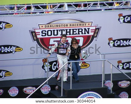 DARLINGTON, SC - MAY 9: Jeff Gordon and his mom coming down the stairs for drivers introductions at the Nascar  race at the darlington raceway southern 500 in Darlington, SC  on May 9, 2009. - stock photo