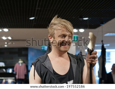 DARMSTADT, GERMANY � MAY, 2014: Television presenter, musical performer, musician and      entertainer Ross Antony at a autograph session for fans on May 24, 2014 in Darmstadt, Germany - stock photo