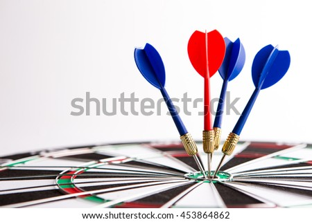 Dart arrow hitting in the target center,Concept of personal coaching success - stock photo