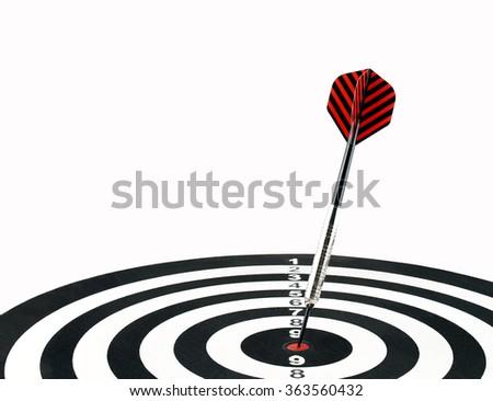 dart arrow hitting in the target center of dartboard, success hitting target aim goal achievement - stock photo