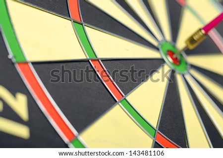 Dart arrows in the target center of dart game
