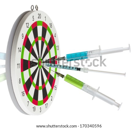 Dart board and syringes - stock photo