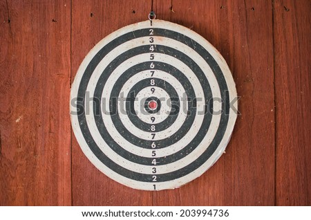 dart board on classical wood wall - stock photo