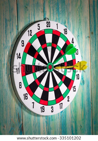 dart board with darts on background - stock photo