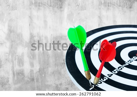 dart go to target on old cement background - stock photo