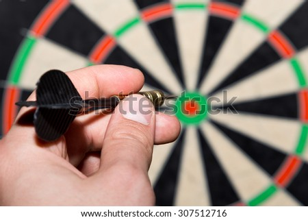 dart in a hand - stock photo