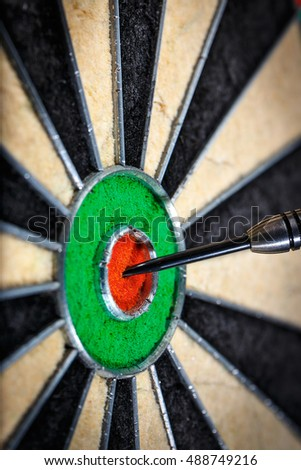dart in bull's eye, close up