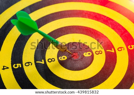 Dart is a competition and opportunity. Dartboard is be like as the target center and goal of business. therefor Bulls eyes of Dart board is both challenge,success,risk management,goal,opportunity - stock photo