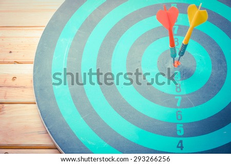 Dart is an opportunity and Dartboard is the target and goal. So both of that represent a challenge - Business concept . Bullseye and Dart. - stock photo