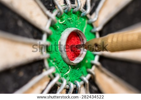 Dart on target, bullseye - stock photo