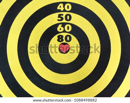 Dartboard color yellow black red heart stock photo download now dartboard color yellow and black with a red heart shaped on center at bullseye for altavistaventures Image collections